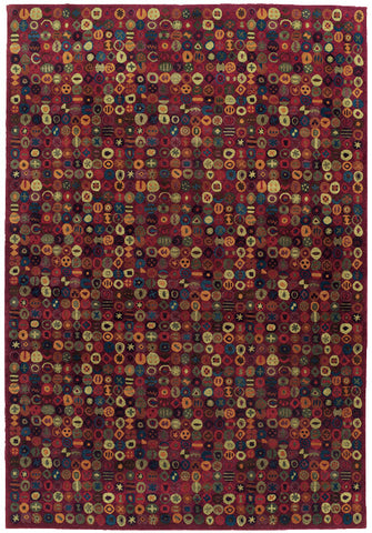 Bottlecaps red is a fun contemporary tibetan area rug with repeating circular shapes with smaller shapes inside the circles and a red background