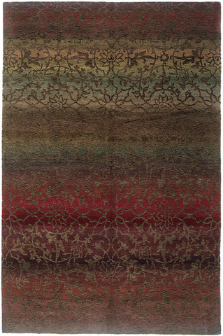 Divine is a luxurious 100 knot hand knotted Tibetan rug with an intricate yet subtle design over flowing gradations of subdued colors