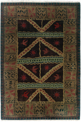 Sundial chocolate - a handmade wool rug with primitive and pleasing shapes and patterns, and richly deep colors.