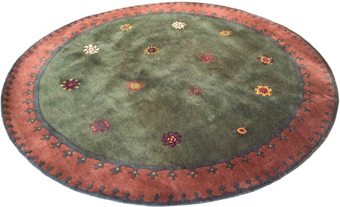 Tibetan Sun (moss) six foot round - a  subtle and playful modern area rug with rich colors