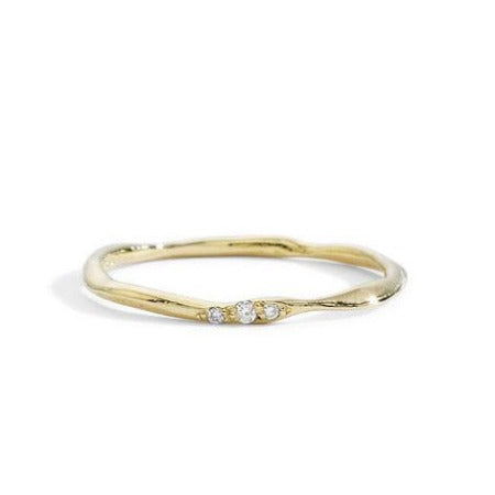 blanca monrós gómez | thin wavy diamond band