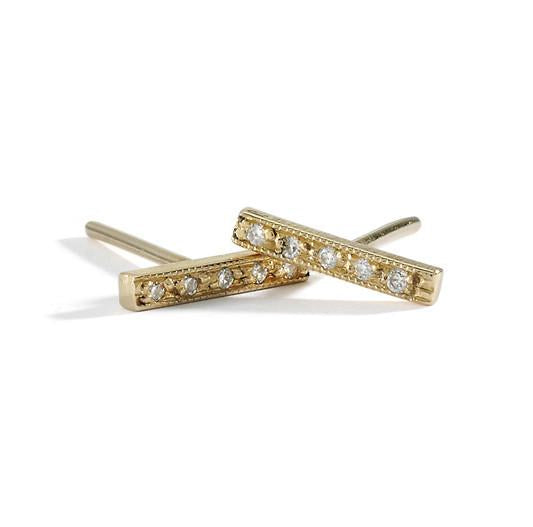 dainty diamond bar studs in yellow gold with white diamonds