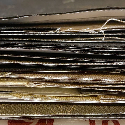 Stack of pieced templates from the side