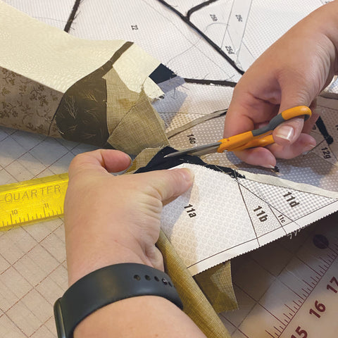Cutting excess fabric by hand