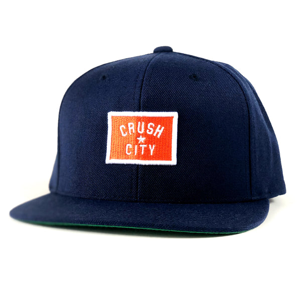 RGC-SnapbackHat-CRUSH-BADGE-NAVY