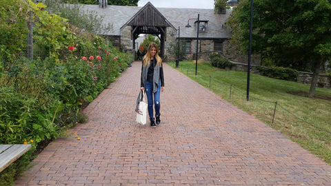 Walking in front of Stone Hill Barns