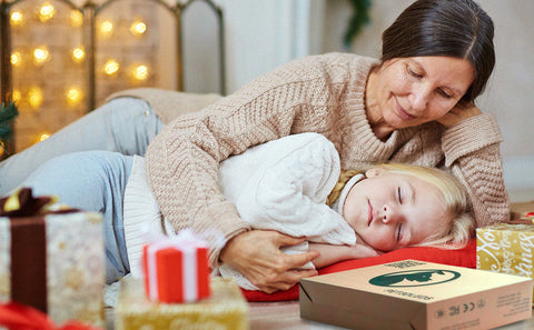 woman lying on ground with pet3dleds boxes