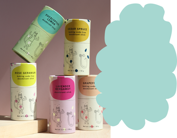 Stack of deodorant sticks with a teal cloud illustration