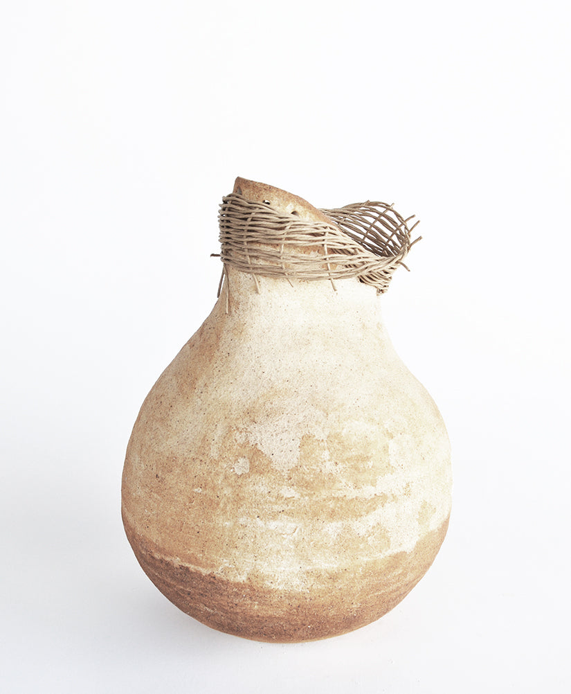 natural pot with hand woven details
