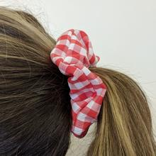 red scrunchy in childs hair