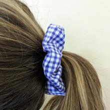 blue scrunchy in childs hair