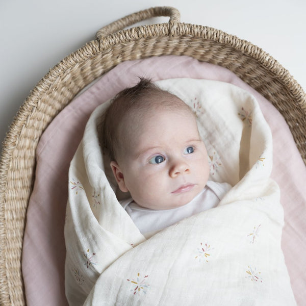 baby wrapped in organic cotton swaddle
