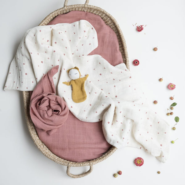 a baby's bed with organic cotton blanket