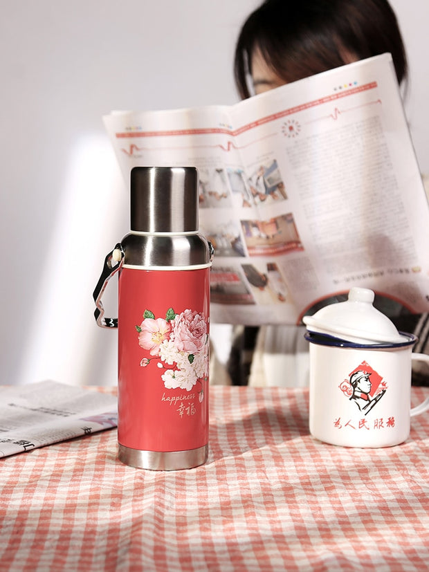 Glamorous stainless steel insulated flask with cup.
