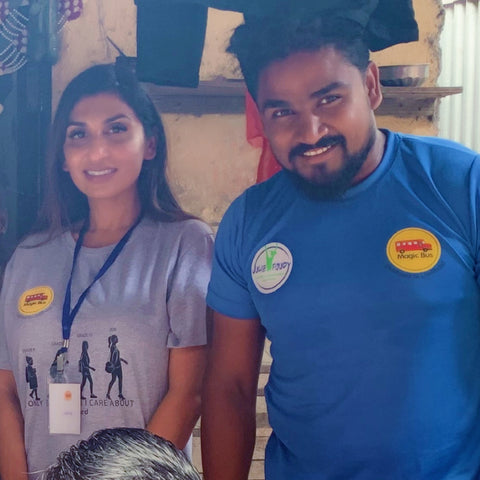 Amita Bhalla and Another Magic Bus member helping children in India