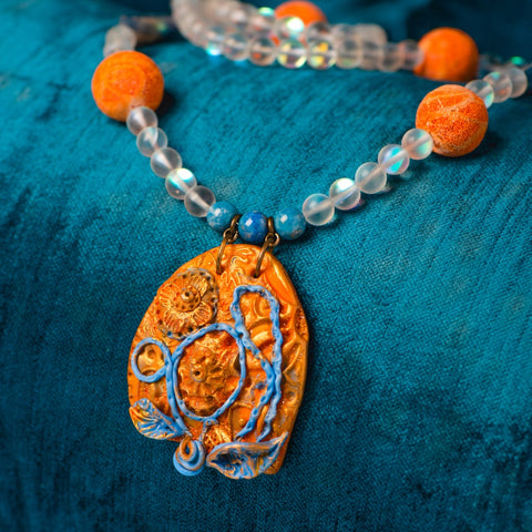 Fashion statement necklace made of clay, spectrolite quartz, dumortierite, fossilized sponge coral and kyanite.