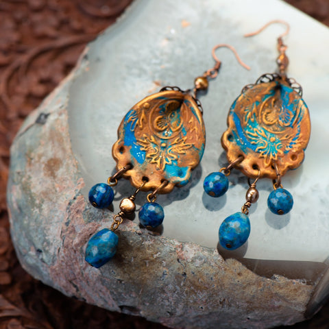 handmade earrings made of clay, lapis, and fresh water pearls.