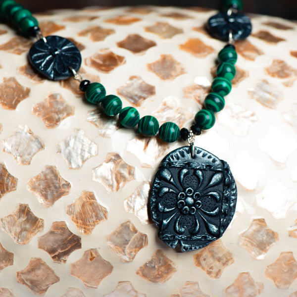 Fashion statement necklace made of clay, malachite and spinal.