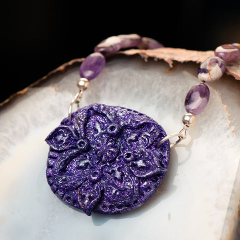 fashion statement necklace made of clay, amethyst, and sterling silver beads.