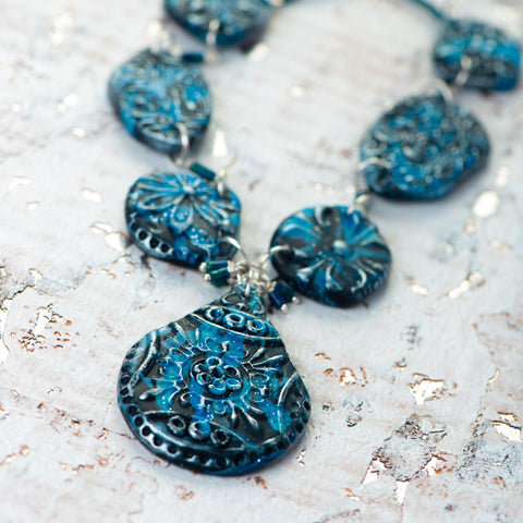 Fashion statement necklace made of clay and chrysocolla.