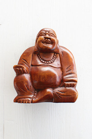 This Happy Buddha was hand carved with love and detail by the local women of Bali.