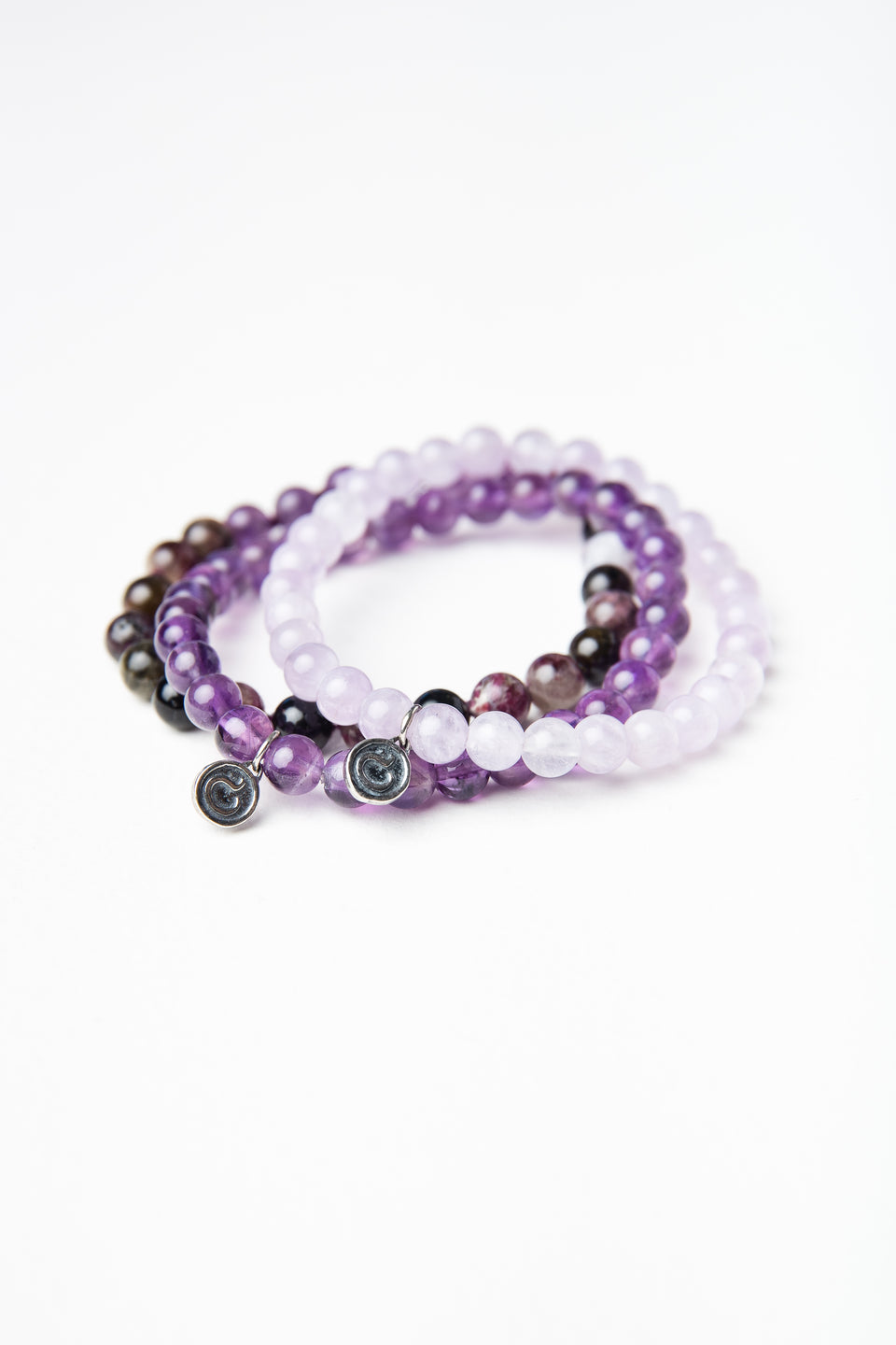 clothed product stone disciple in purple bracelet lightbox