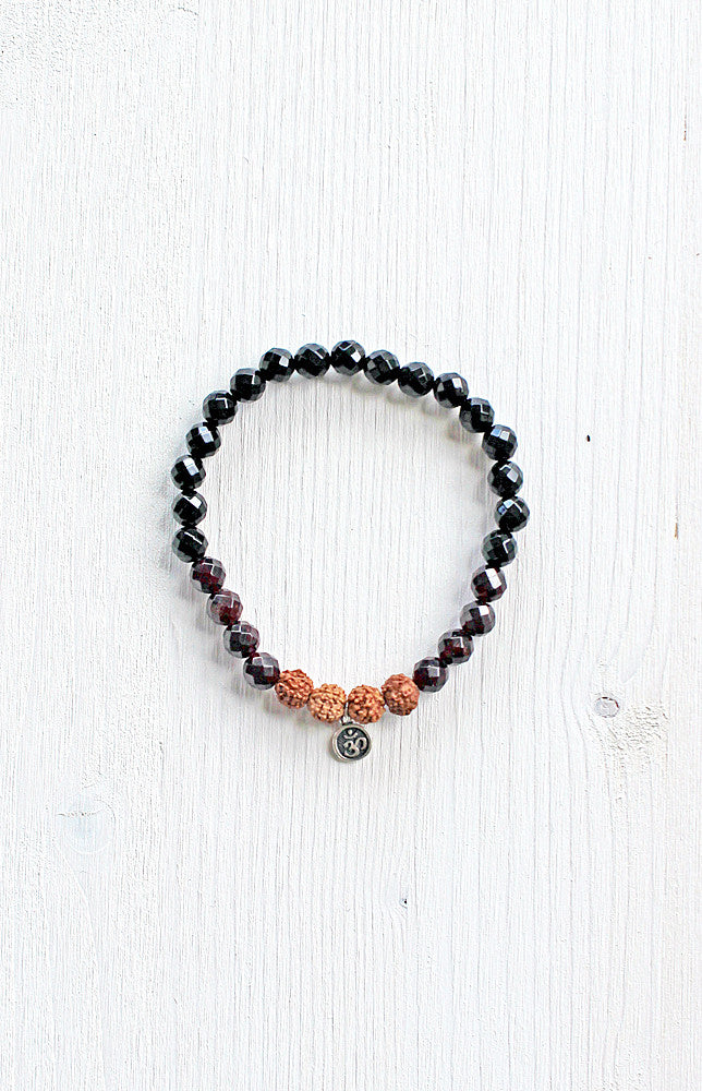 Shiva & Shakti Bracelet made with faceted Onyx and Garnet.