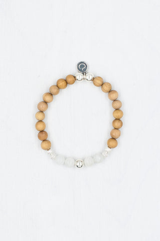 Harmony bracelet made with sandalwood, moonstone, and silver.