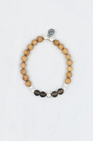 Honour Bracelet made with sandalwood, smokey quartz, and silver.