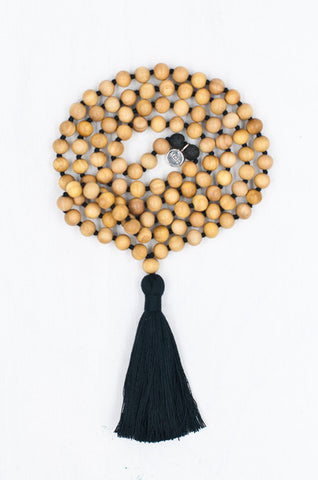 A simple yet sacred combination of sandalwood beads forms this perfect mala