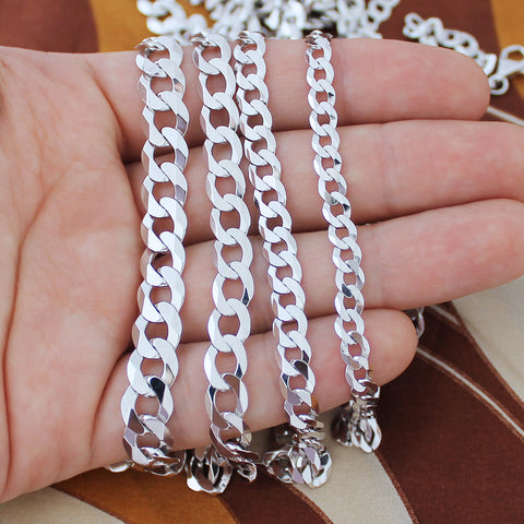 Silver cuban curb chains in hand