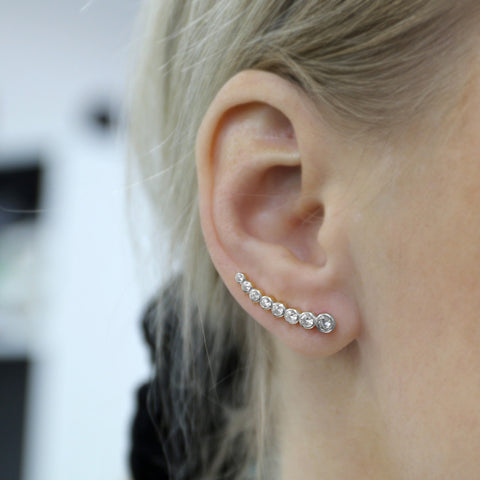 woman wearing silver climber earrings