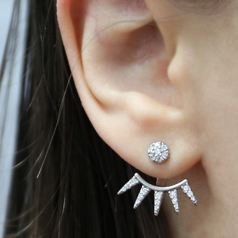 Girl wearing stylish spiked earrings