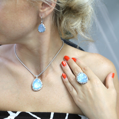 Woman wearing silver milky aquamarine jewelry
