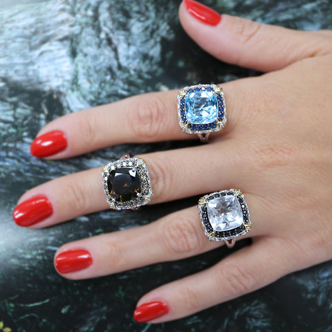 woman wearing red nail polish and big gemstone rings