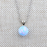 Solid Sterling Silver Rhodium Plated 6mm Light Blue Simulated Opal Pendant Necklace, pendant only