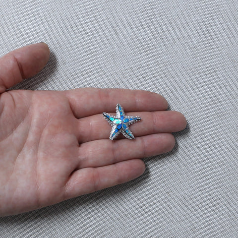 Solid Sterling Silver Rhodium Plated Simulated Blue Opal Textured Starfish Pendant