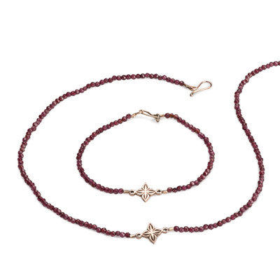 Anahita 2 necklace and bracelet in 9ct rose gold with garnet beads