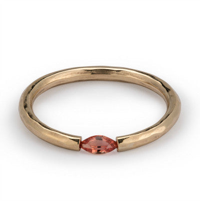 Hammered Tension set gold ring with pink garnet