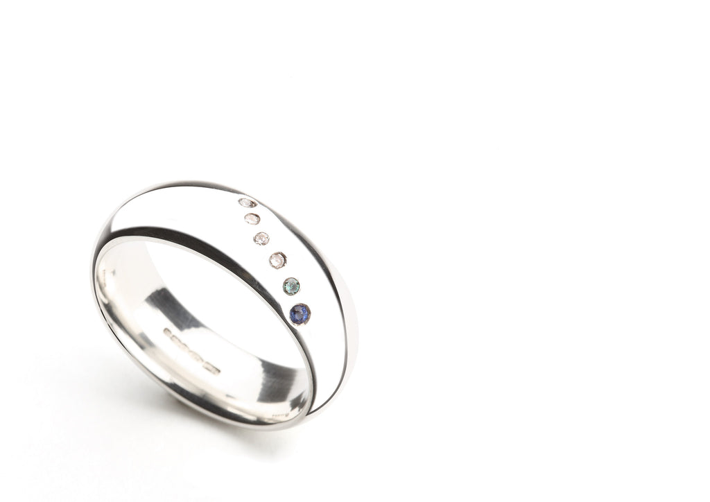 Wave Ring in Silver, Diamond, Blue Sapphire and Topaz.
