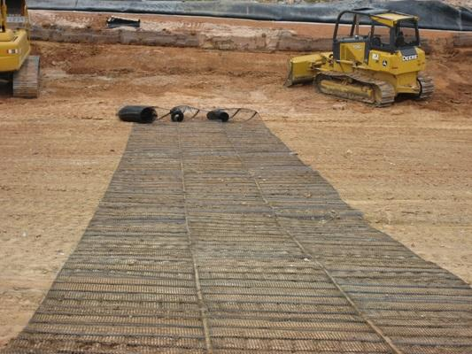 Tensar Uniaxial Geogrid installed over graded dirt