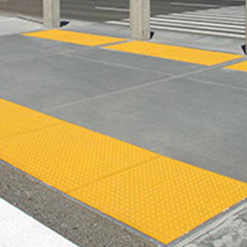Armor Tile Cast In Place Detectable Warning Mats yellow at crosswalk