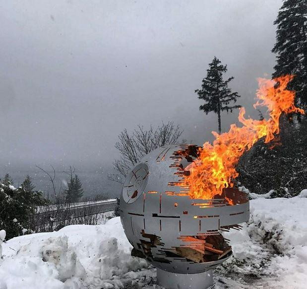 Death Star Fire Pit Silver in the snow