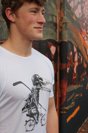 Model wearing White Tencel T-shirt with bear on bicycle with skull helmet