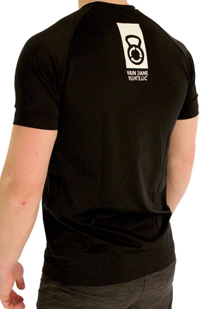 Model wearing Vain dane athletic men's running shirt in econyl yarn