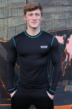 Model wearing vain dane athletic long sleeved running shirt for men. Made with ECONYL yarn.