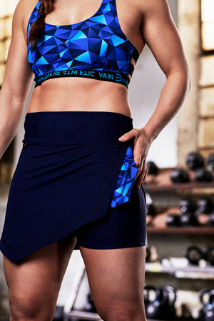 Agni skort in blue with detail. Inner tights are visible
