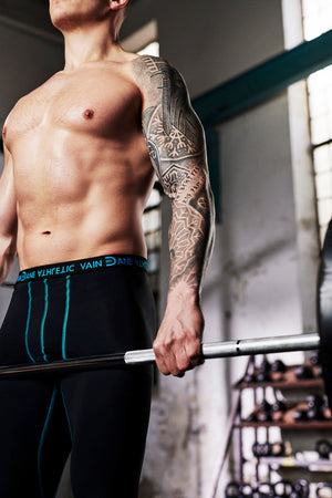 Vain Dane Athletic men's leggings with compression. Made with regenerated nylon from discarded fishing nets. Seen on model deadlifting
