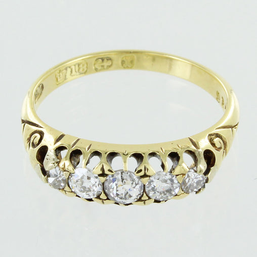 LADIES 18KT GOLD DIAMOND WEDDING BAND