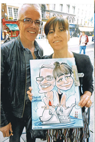 Duane and Lorraine think theres something fishy about their caricature - Green Gallery